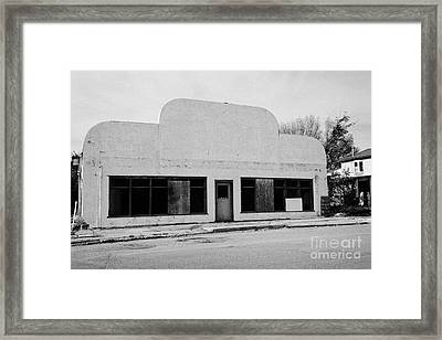 empty unused abandoned store the town of leader sk Canada Framed Print