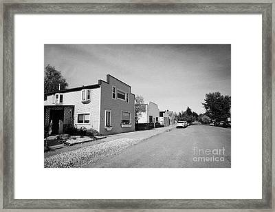 empty unused abandoned stores converted to homes on the town of leader sk Canada Framed Print by Joe Fox