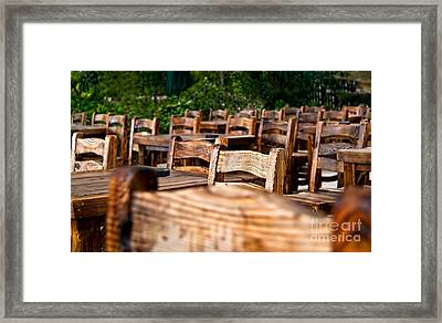 Empty Wooden Chairs And Tables Framed Print