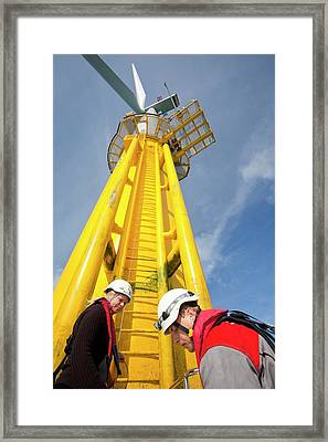 Engineer Climbing A Transition Piece Framed Print by Ashley Cooper