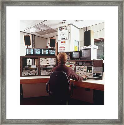 Engineer Siting In Front Of Control Panel Framed Print by Dorling Kindersley/uig