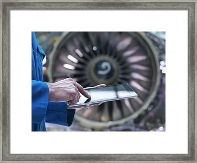 Engineer Using Digital Tablet In Front Framed Print by Monty Rakusen