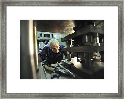 Engineer With A Metal Press Framed Print by Science Photo Library