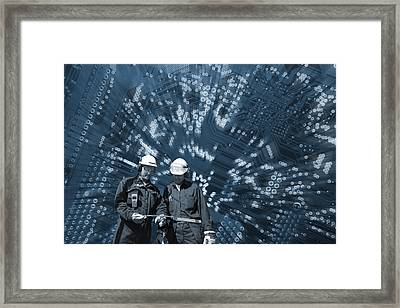 Engineers In A Futuristic World Framed Print