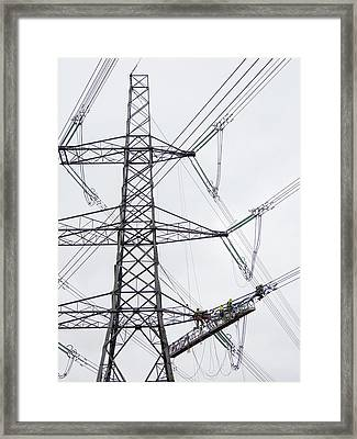 Engineers Working On Power Lines Framed Print by Ashley Cooper