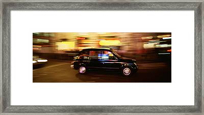 England, London, Black Cab In The Night Framed Print