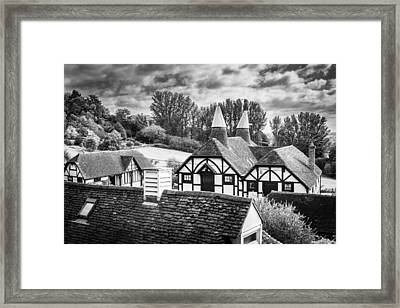 Framed Print featuring the photograph English Rooftops. by Gary Gillette