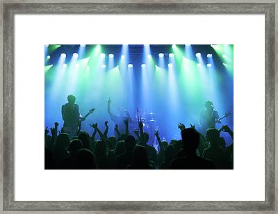 Enjoying Every Song The Band Plays Framed Print by Yuri arcurs