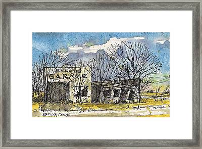 Enochs Garage Framed Print by Tim Oliver
