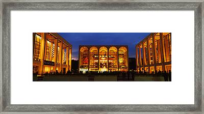 Entertainment Building Lit Up At Night Framed Print