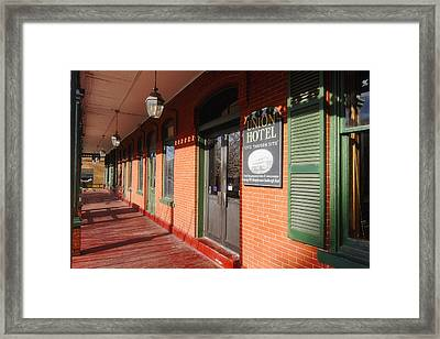 Entrance Of The Union Hotel Framed Print by George Oze