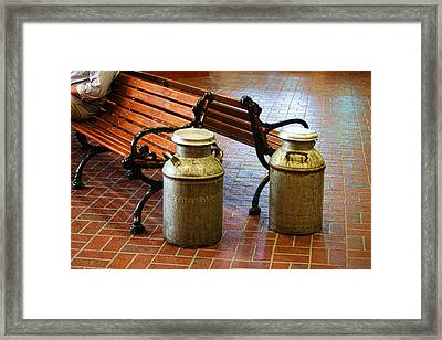 Wooden Bench With Milk Cans Framed Print