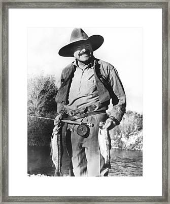 Ernest Hemingway Fishing Framed Print by Underwood Archives