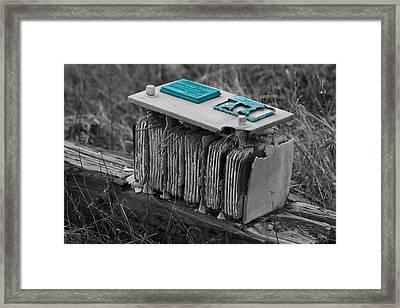 Eroding Battery Framed Print