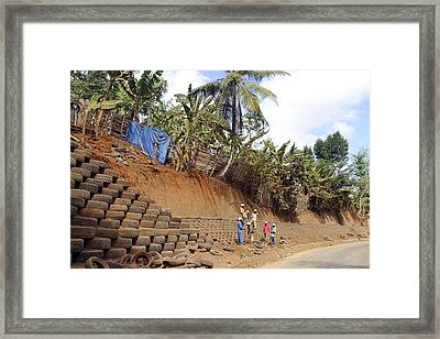 Erosion Control With Tires Framed Print by M. Watson