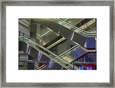 Escalators At Dubai Airport Framed Print by Mark Williamson