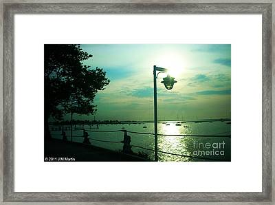 Escaping The Lamp Framed Print by Jay Martin