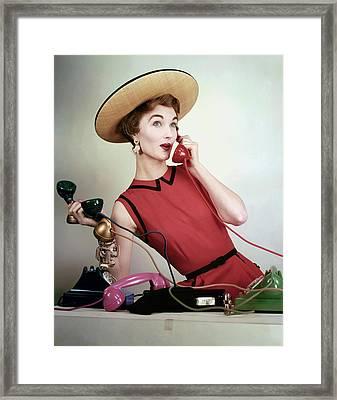 Evelyn Tripp Holding Telephones Framed Print