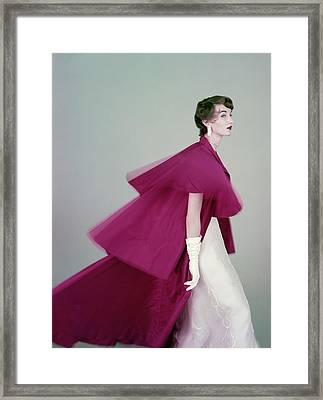 Evelyn Tripp Wearing A Mainbocher Coat Framed Print by Richard Rutledge