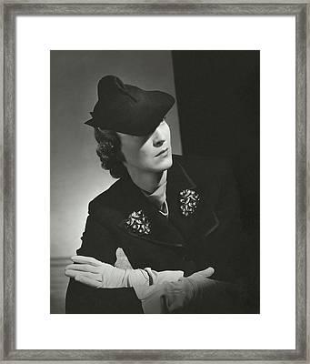 Evelyne Greig Modeling A Military Hat Framed Print by Horst P. Horst