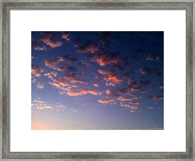 Evening Embracing Clouds Framed Print by Amanda Holmes Tzafrir