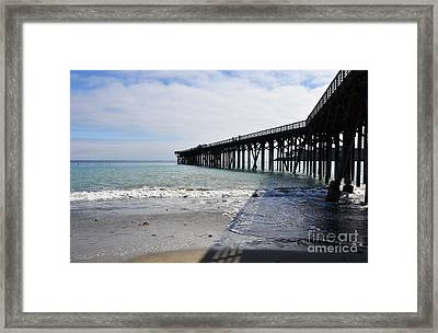 Framed Print featuring the photograph Evening Pier Shadows Are Lost In The Surf by Debby Pueschel