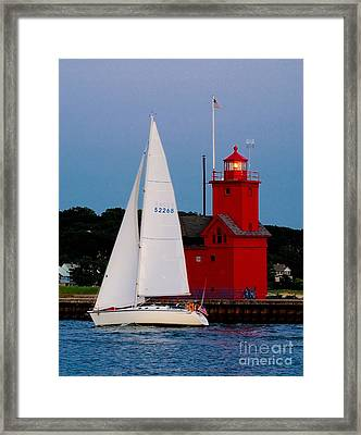 Evening Sail At Holland Light Framed Print by Nick Zelinsky