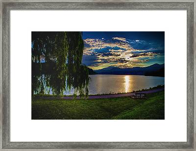 Evening Sun Kisses Lake One Last Time Framed Print by Dennis Baswell