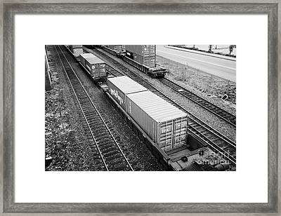 evergreen and tex freight shipping containers on rail cars freight train goods tracks Vancouver BC C Framed Print by Joe Fox