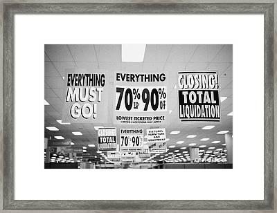 everything must go total liquidation closing signs in a store in Saskatoon saskatchewan canada Framed Print