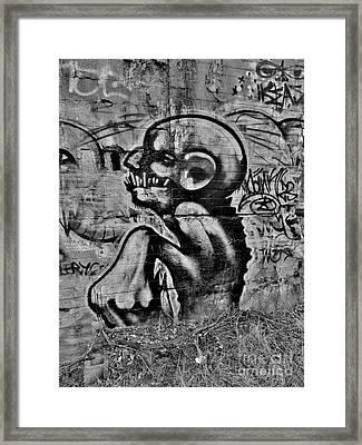 Evil Lerks  Framed Print
