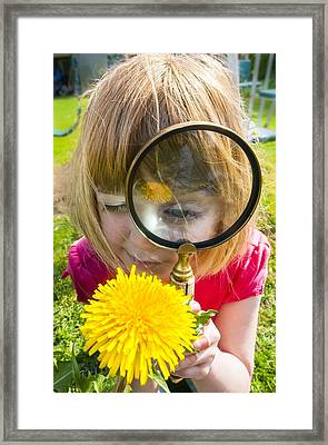 Examining Flower With Magnifying Glass Framed Print