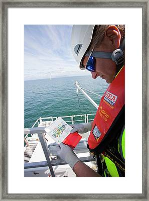 Executive Climbs A Wind Turbine Framed Print