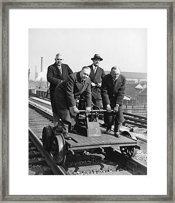 Executives Commute By Handcar Framed Print