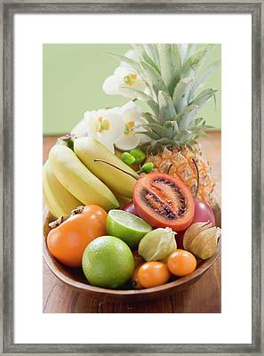 Exotic Fruit, Citrus Fruit And Orchids In Wooden Bowl Framed Print