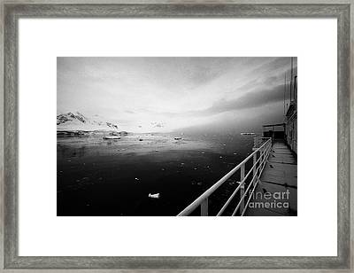 expedition ship covered in snow moored in Fournier Bay on Anvers Island Antarctica Framed Print by Joe Fox