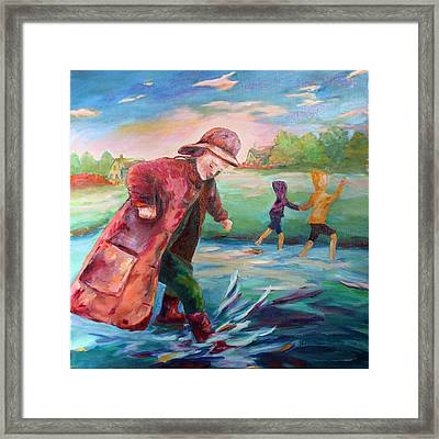 Exploring Puddles Framed Print by Naomi Gerrard