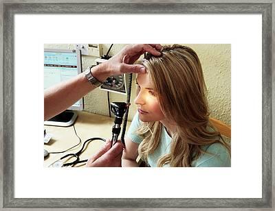 Eye Examination Framed Print