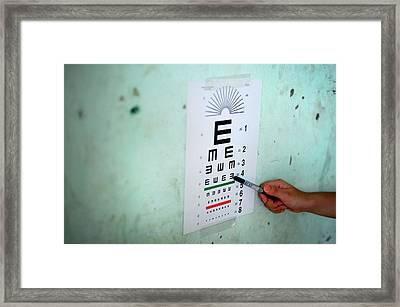Eye Test During Humanitarian Exercise Framed Print by Sara Csurilla