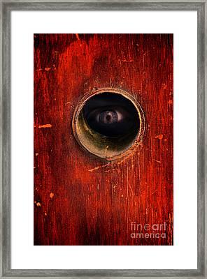 Eye Through Hole In A Door Framed Print