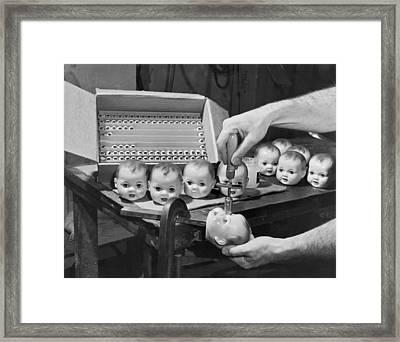 Eyeballs Put In A Doll Head Framed Print by Underwood Archives