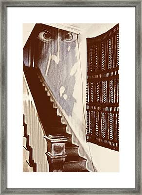 Eyes At The Top Of The Stairs Framed Print