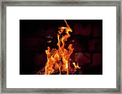 Eyes In The Flame Framed Print by Sheila Haddad