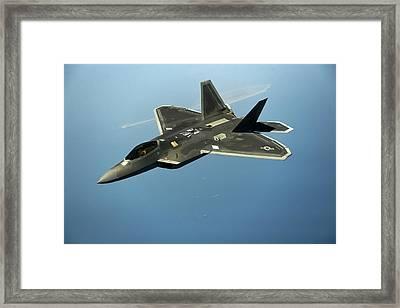 F-22 Raptor Flies Over Arabian Gulf  Framed Print by Staff Sgt Vernon Young Jr