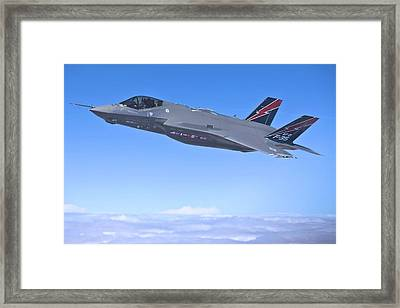 F 35 Joint Strike Fighter Lightening II Red And Indigo Vertical Angled Stabilizers Enhanced Framed Print by US Military - L Brown