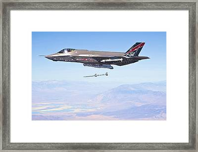 Lockheed Martin F-35 Launching Missile Enhanced Framed Print by US Military - L Brown