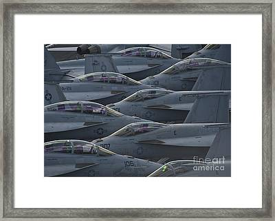 Fa18 Super Hornets Sit On The Flight Deck Of The Aircraft Carrier Uss Enterprise  Framed Print by Paul Fearn