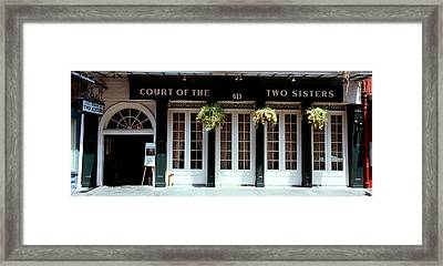 Facade Of A Restaurant, Court Of Two Framed Print by Panoramic Images