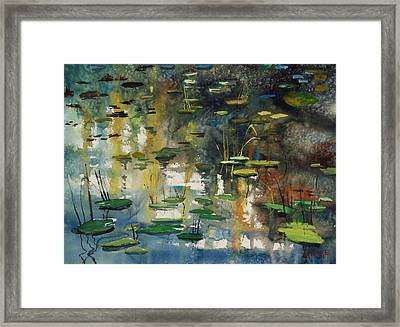 Faces In The Pond Framed Print