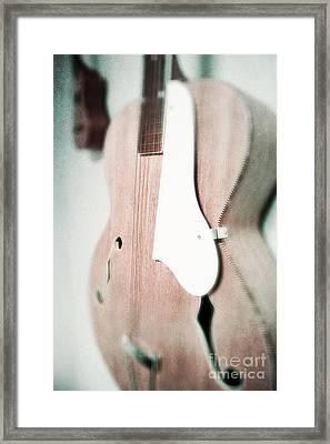 Faded Guitars Framed Print